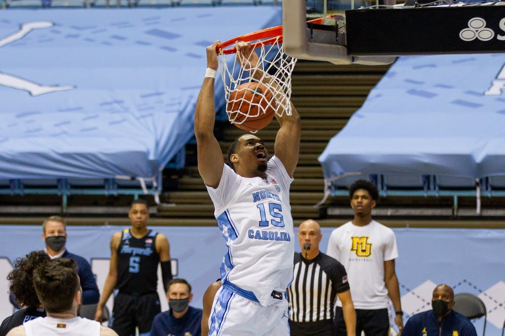 UNC senior forward Garrison Brooks (15) dunks the ball during a game against Marquette in the Smith Center on Wednesday, Feb. 24, 202. UNC lost to Marquette 83-70.