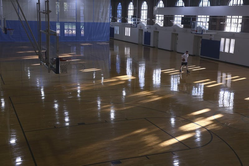 Basketball players frequent Woolen Gym for pickup games.