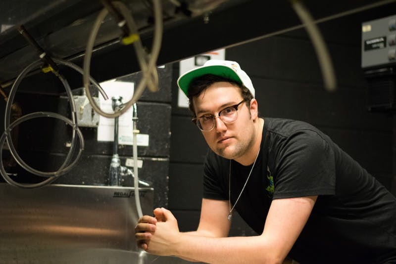 Jubal Strube, a senior studio art major, spends much of his time in the Hanes Art Center darkroom.
