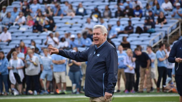 UNC football coach Mack Brown observes his team during the Spring Football Game on April 13, 2019 in Kenan Stadium. The Carolina team defeated the Tar Heel team 25-10.