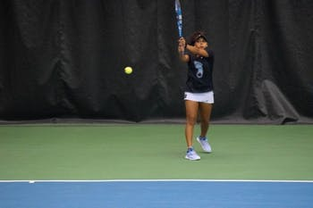 Sophia Patel, UNC, First-year, returns a serve during the 15th annual Kitty Harrison Invitational competition. Patel and Chloe Ouellet-Pizer, UNC, Senior, had previously won their first match during the doubles competition on Friday, November 2. Patel had also won a singles victory of the course of the competition.
