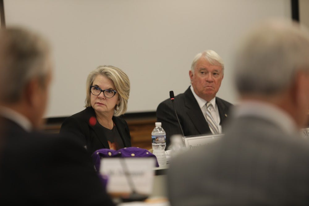 <p>UNC-system President Margaret Spellings (left) sits next to chairperson Lou Bissette (right) during a September 2017 UNC Board of Governors meeting.</p>