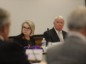 UNC-system President Margaret Spellings (left) sits next to chairperson Lou Bissette (right) during a September 2017 UNC Board of Governors meeting.