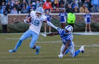 Wide reciever Dazz Newsome (19) escapes Duke wide reciever Damond Philyaw-Johnson (85) at Wallace Wade Stadium on Nov. 10, 2018.