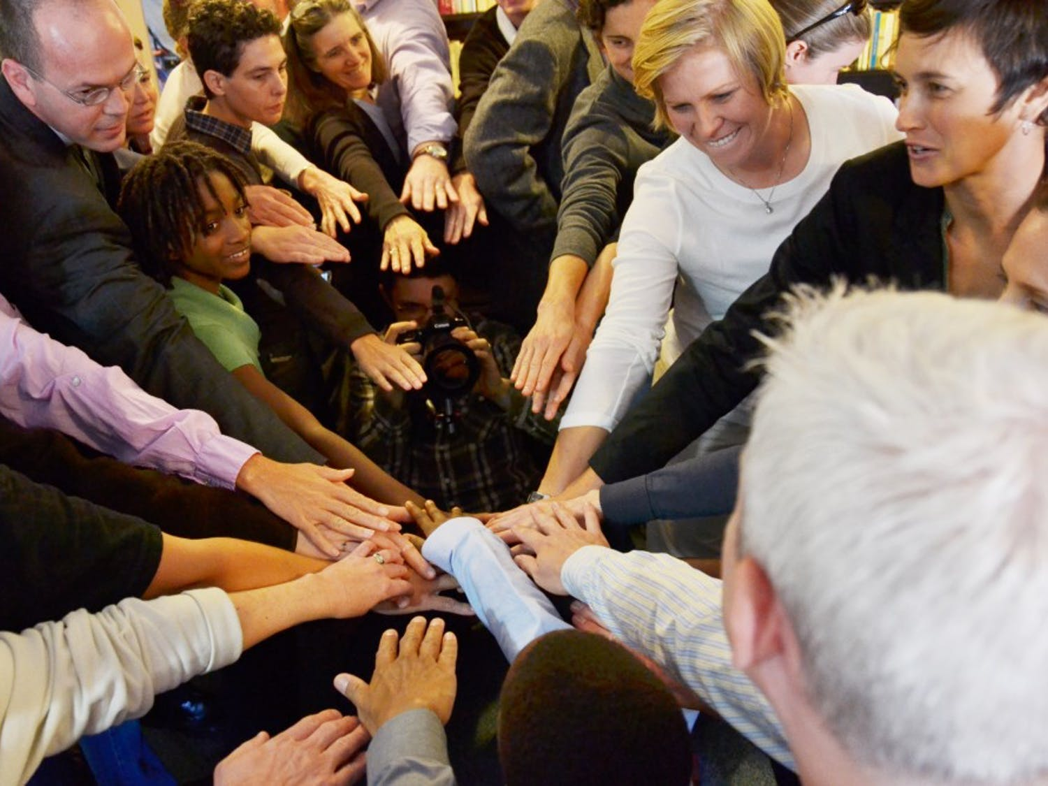 Supporters of Moore and Perez gathering for a huddle before processing to the Reister of Deeds including pastor Brian Cole (Cathedral of All Souls), executive director of Campaign for southern equality Jasmine Beach-Ferrara (right corner) and her partner, Meghann Burke, a lawyer who is helping arrange representation for the couple that will be arrested Friday