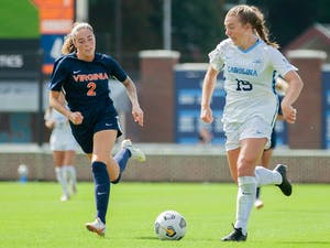 Sophomore forward/midfielder Avery Patterson (15) dribbles the ball at the game against Virginia on Oct. 3 at Dorrance Field. UNC tied 0-0.