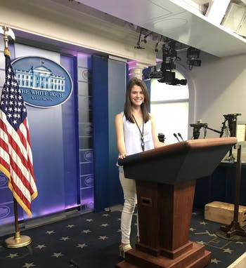UNC-Chapel Hill sophomore Betsy Byrne poses at the Press Briefing Room's podium in the White House's West Wing. Byrne interned at the White House this past summer. Photo courtesy of Byrne.