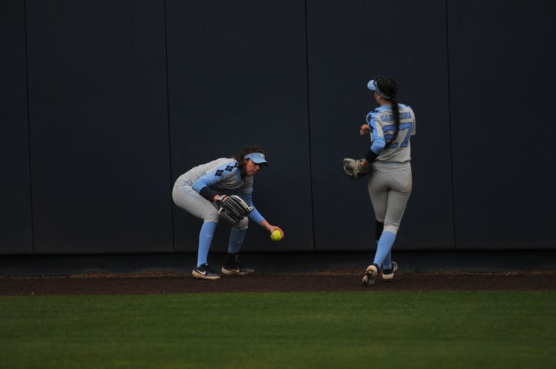 (From left) UNC junior outfielder Kristina Burkhardt (10) and UNC first-year Bri Stubbs (27) return the ball during a game against Elon on Wednesday, Feb. 26, 2020 in G. Anderson Softball Stadium. UNC lost to Elon 2-1.