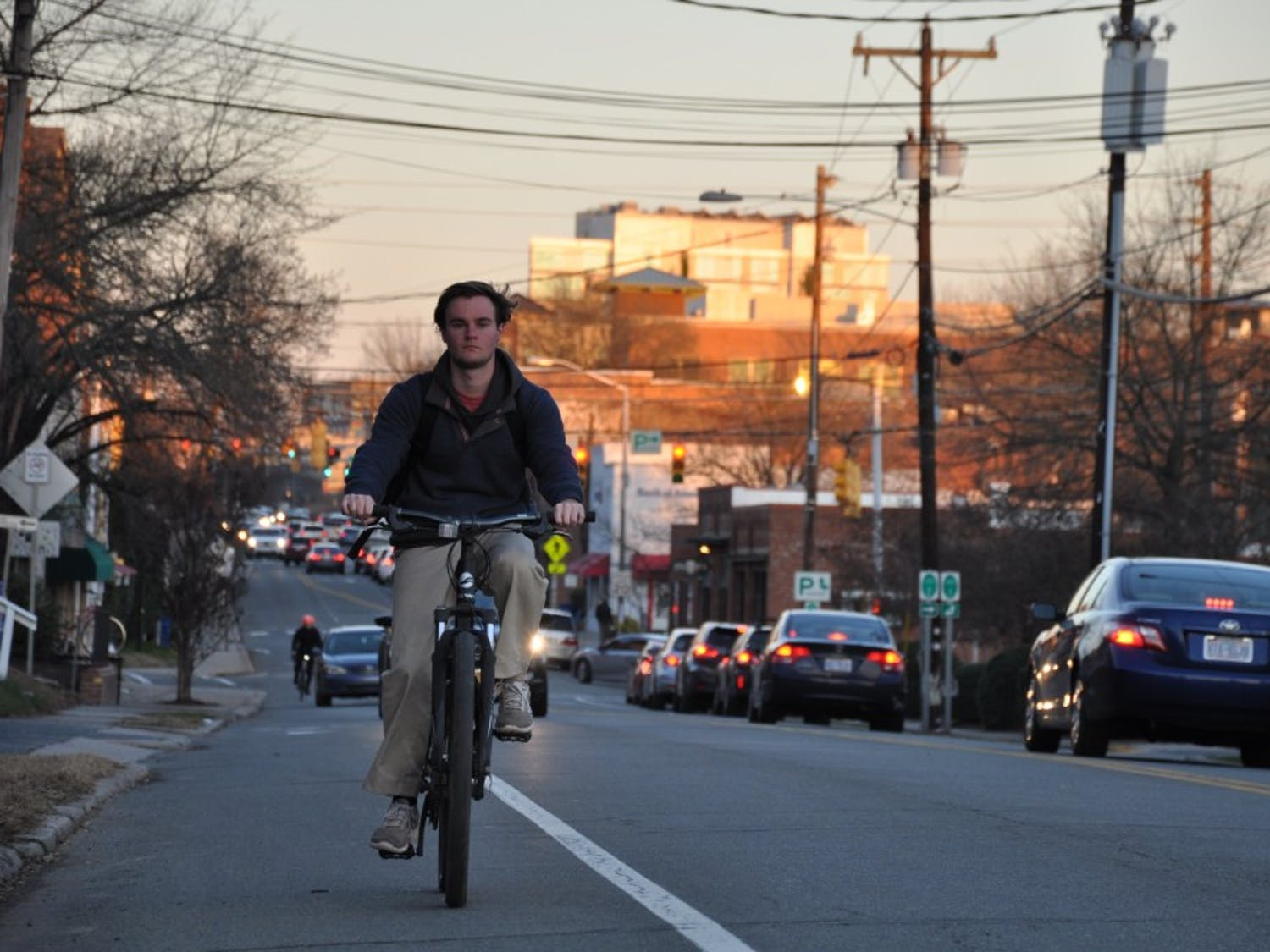 UNC student George Ellington rides his bike down West Main Street in Carrboro.