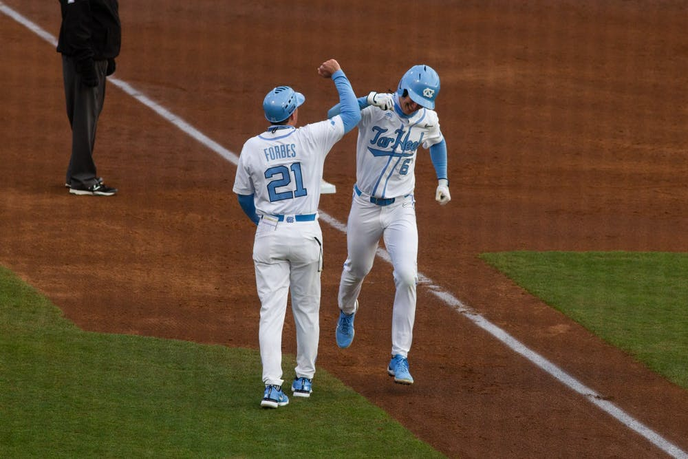 UNC first year second baseman Tyler Causey celebrates a home run with head coach Scott Forbes during Carolina's 8-1 season-opening victory over James Madison at Boshamer Stadium, Feb. 19, 2021.