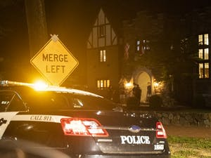 A police car parked on Franklin Street outside of UNC's Alpha Tau Omega (ATO) fraternity on Saturday, Aug. 29, 2020 after a report that ATO was hosting a party that Saturday night.