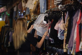 Katie Mullett, a sophomore psychology major, browses the clothing section at Rumors.