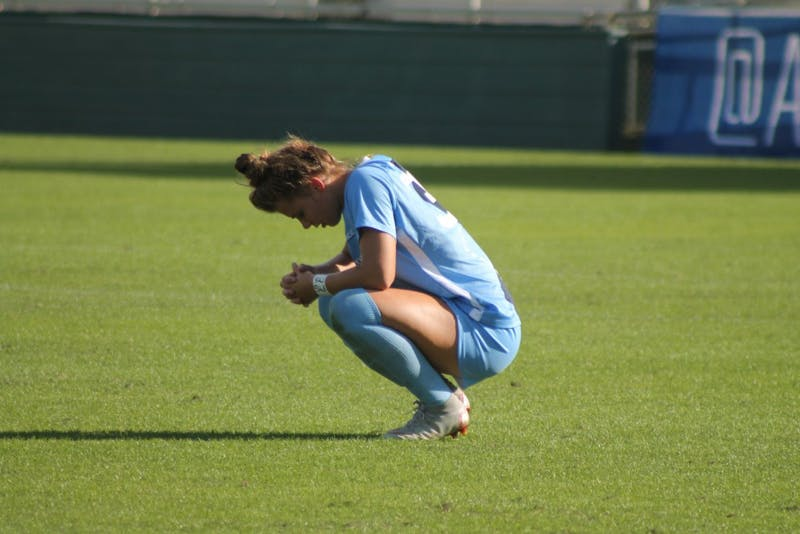 Sophomore defender Brooke Bingham (30) crouches on the field after the Tar Heels' women's soccer team loses to the Florida State Seminoles in the 2018 ACC Championship game on Sunday, Nov. 4.