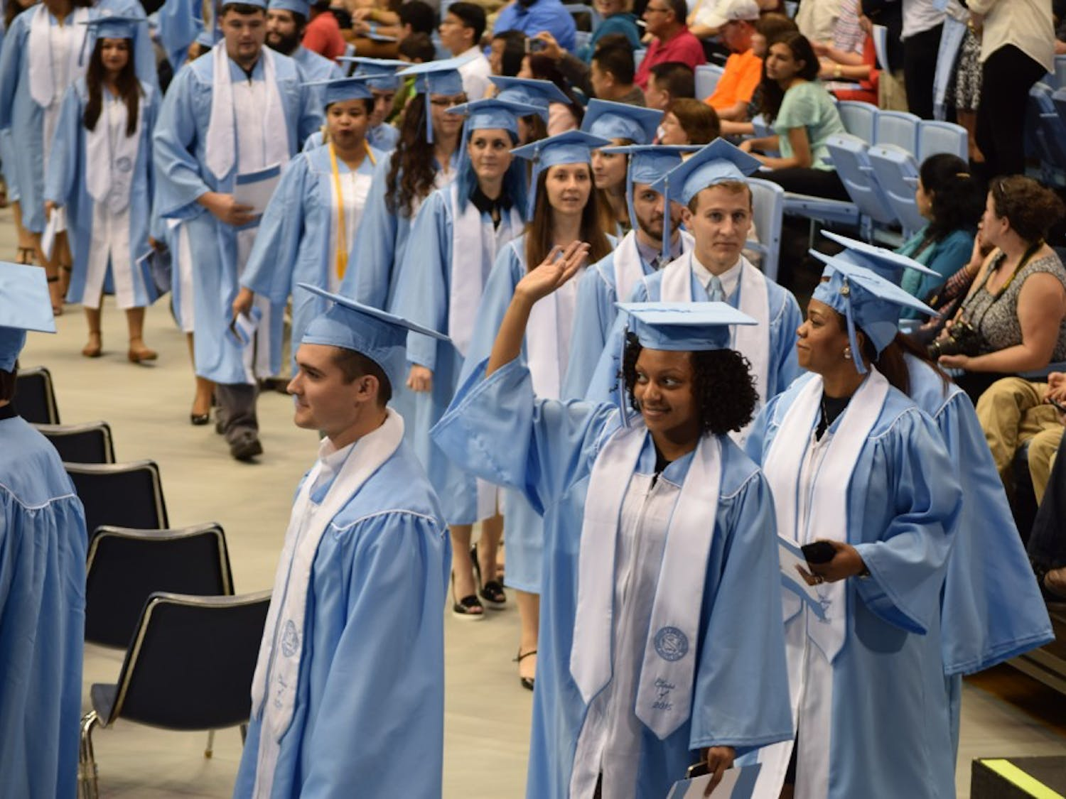 Students walk in for graduation.