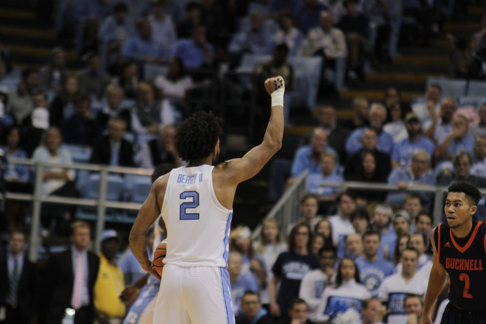 <p>Guard Joel Berry II (2) raises his fist to start an offensive possession against Bucknell on Nov. 15 in the Smith Center.</p>