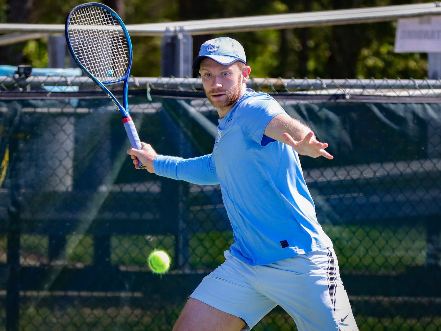 UNC sophomore Simon Soendergaard returns the ball with a forehand shot during the Tar Heels' 4-3 victory over Miami on Friday, April 16.