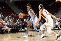 Junior guard Shayla Bennett (0) controls the ball during the Tar Heel's 100-69 season opener win against Elon university at the Schar Center in Elon, North Carolina Tuesday, Nov. 6, 2018.