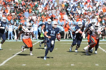 Quarterback Nathan Elliott (11) scrambles against Miami on Oct. 28 in Kenan Stadium.