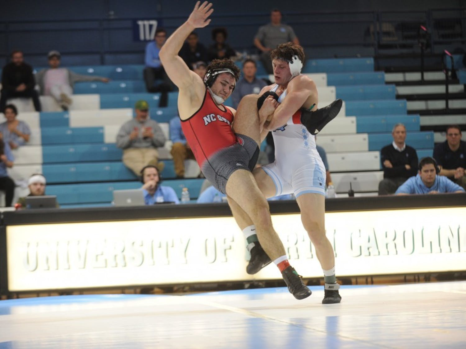 UNC redshirt senior Cory Daniel takes down NC State's Colin Lawler on Friday, Feb. 15, 2019. NC State won the wrestling match 20-14.