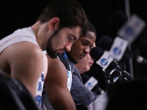 UNC senior forward Luke Maye (32) and senior guard Kenny Williams (24) answer questions after UNC's 97-80 loss against Auburn in the Sweet 16 of the NCAA Tournament on Friday, March 29, 2019 at the Sprint Center in Kansas City, M.O.