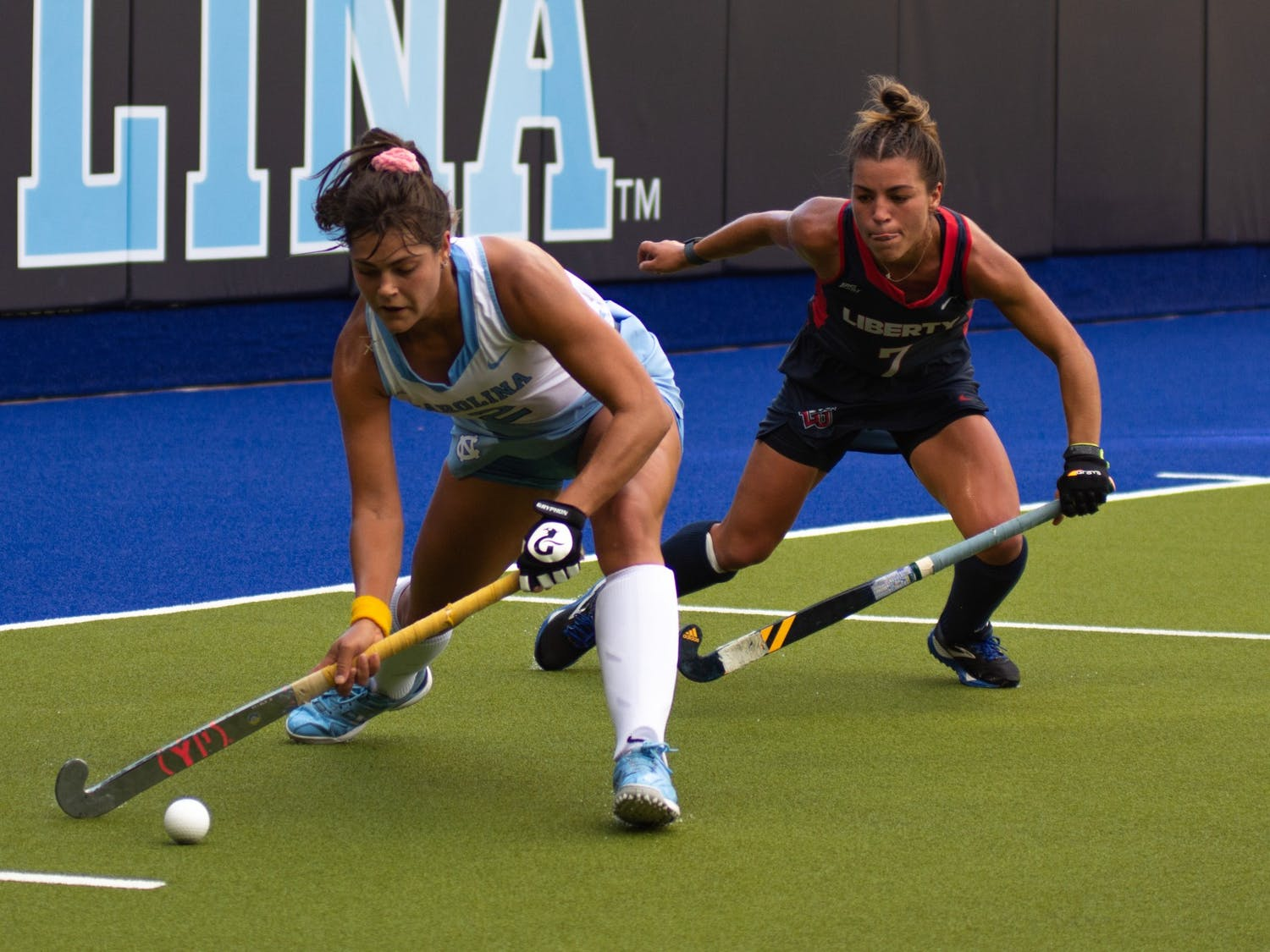 Senior forward Meredith Sholder (2) bats the ball during UNC's Oct. 10 field hockey game against Liberty. The game proved to be a loss for the Tar Heels–Liberty headed home with a 4-0 win.