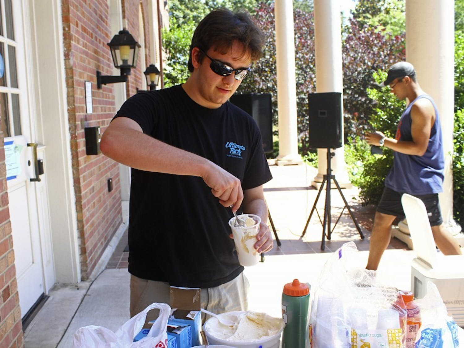 Junior Jarratt Edwards makes a homemade ice cream sundae at Kenan Fest held at Kenan Quad on Friday afternoon