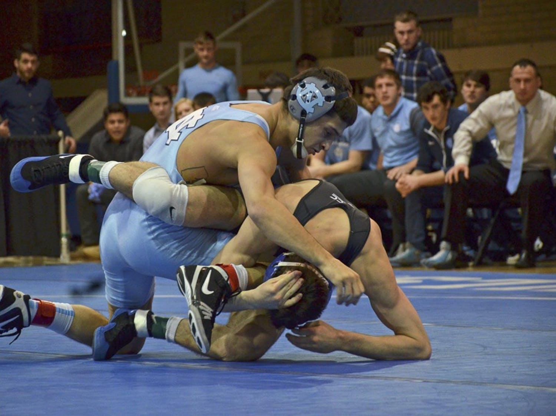 UNC's Joey Ward defeats Duke opponent Zach Finesilver on Wednesday evening in Durham.