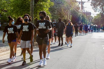 UNC athletes march down Franklin Street for the #MarchOnMyCampusMovement on Saturday, Aug. 29, 2020.