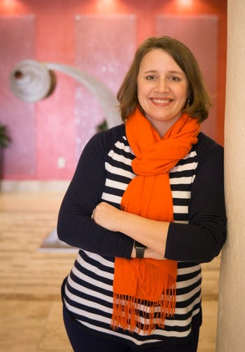 Chapel Hill-Carrboro City Schools PTA President Erin Schwie Langston poses in her office building at Southern Village in Chapel Hill.