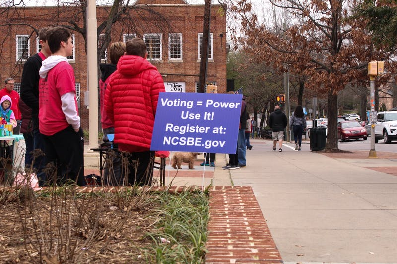 Volunteers in Chapel Hill offer voter registration assistance on Feb. 9, 2020 in front of the post office on Franklin Street. North Carolina and Orange County are continually focusing on improving the voting process for the upcoming primaries.