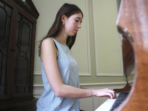 Junior geography and psychology major Emma Armstrong-Carter plays the piano in McIver Residence Hall. McIver is one of 11 residence halls on campus with a piano.