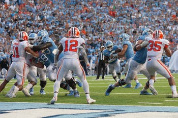 UNC quarterback Sam Howell (7) fakes a handoff to running back Javonte Williams (25) on a late two-point conversion attempt against No.1 Clemson. When the play came up short, UNC lost 21-20 on Saturday, Sept. 28, 2019 in Kenan Memorial Stadium.