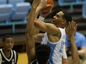 UNC senior forward Garrison Brooks (15) takes a shot in the Dean Smith Center on Jan. 20, 2021. The Tar Heels were behind the Demon Deacons 33-31 at halftime.