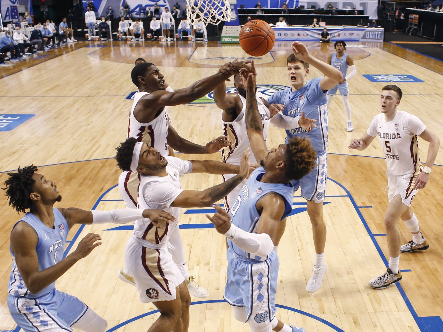 Florida State's Anthony Polite (2), Florida State's Sardaar Calhoun (24) and Florida State's RaiQuan Gray (1) go after the rebound with North Carolina's Anthony Harris (0) and North Carolina's Walker Kessler (13) during the first half of UNC's game against Florida State in the seminfinals of the ACC Men's Basketball Tournament in Greensboro, N.C., Friday, March 12, 2021. Photo courtesy of Ethan Hyman.