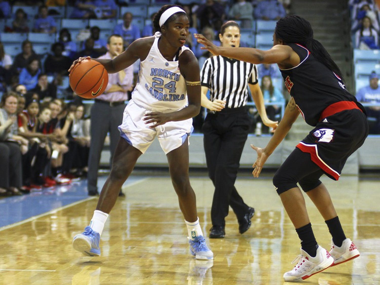 The women's basketball team lost 60-78 to Louisville Thursday night, Feb. 4. First-year Destinee Walker (24) dodges an opponent.