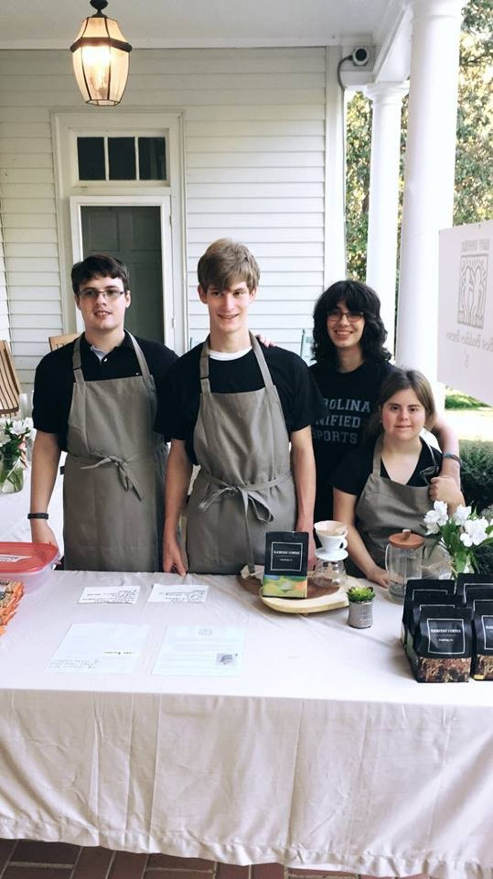 Brian O'Donnell, Max Van Name, Anna Coleman and Lucia Romano (left to right) at a Best Buddies Brew pop-up.