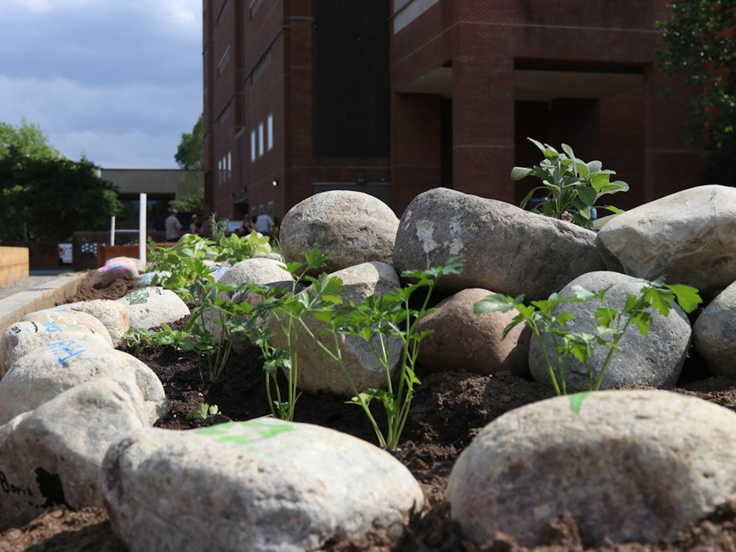 The university celebrated Earth Week with the opening of a new edible campus location and a greenhouse.