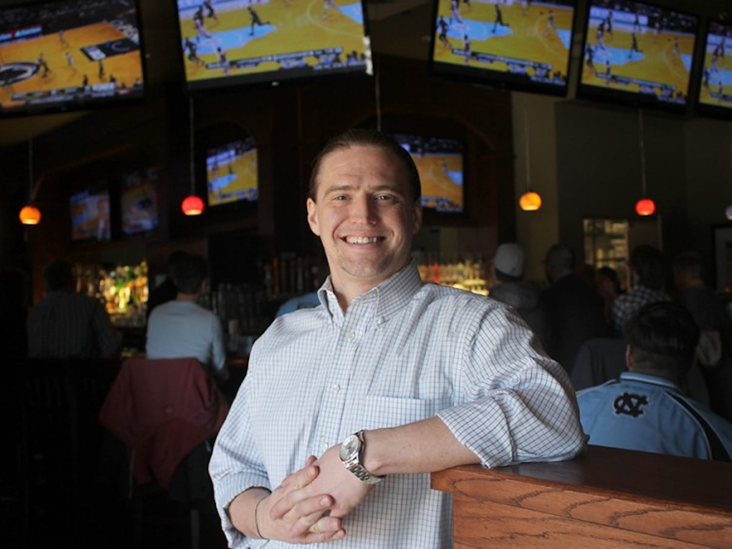 """Brent Walls, a UNC alum, is the general manager of Hickory Tavern, a new restaurant in Carrboro. """"I've been to 24 different countries, all across the world, and this is the place to be."""""""