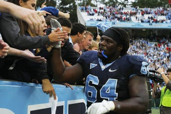 Jonathan Cooper greets fans after a game in UNC's Kenan Stadium.