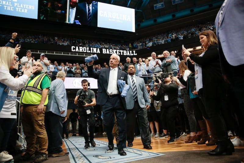 Head Coach Roy Williams prepares to toss t-shirts into the crowd ahead of a game against Duke in the Smith Center on Saturday, Feb. 8, 2020. The Tar Heels lost to the Blue Devils 98-96.