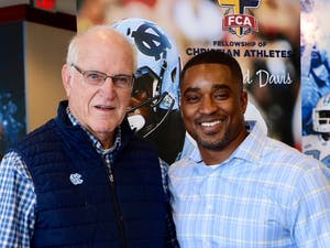 Albert Long (left), a legendary four-sport letter winner and UNC alumnus, with UNC football's chaplain Mitch Mason (right). Photo courtesy of Mitch Mason.