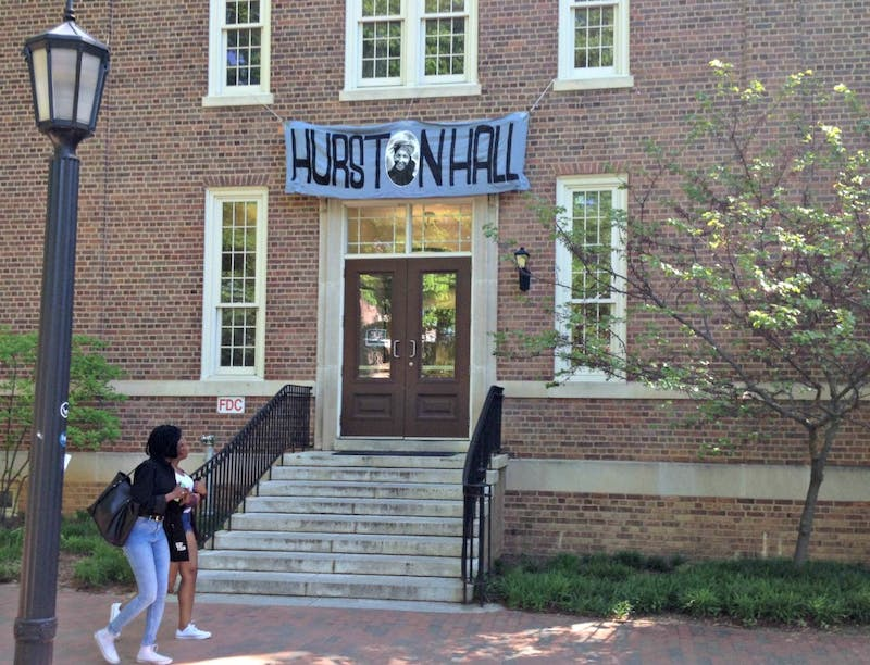 "Student activists placed a banner reading ""Hurston Hall"" over the name plaque of Saunders Hall Friday, April 24, 2015. It has since been renamed ""Carolina Hall."""