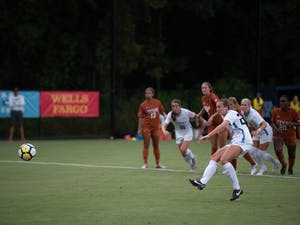 UNC senior midfielder Dorian Bailey (29) shoots a penalty kick against No. 21 Texas in the first half of the team's 1-1 tie on Aug. 22 at Finley Field South.