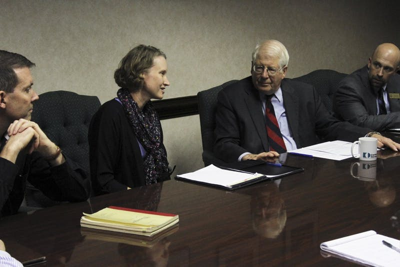 Congressman David Price-D (right) visited the Center for Developmental Science Tuesday afternoon. Andrea Hussong, the center's director, gave Price a tour and hosted a meeting to discuss federal funding for research programs.