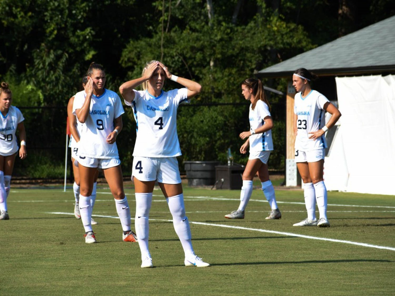 First-year midfielder Rachael Dorwart (9) stands behind junior forward Bridgette Andrzejewski (4) during UNC's 3-1 win over Illinois on Aug. 16 in Chapel Hill.