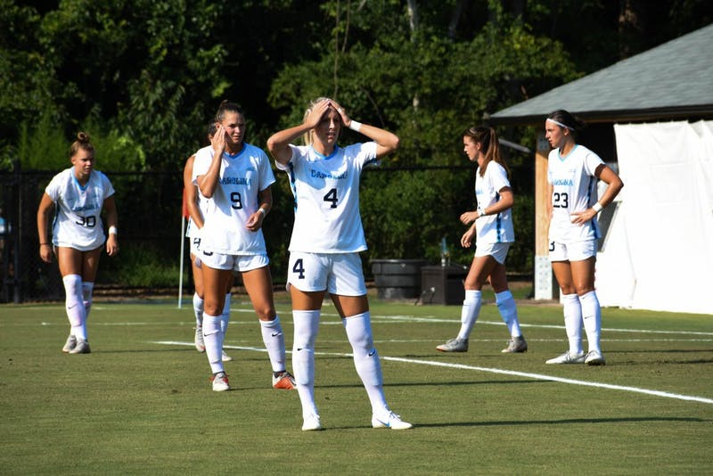 First-year midfielder Rachael Dorwart (9) stands behind junior forward Bridgette Andrzejewski (4) during UNC's 3-1 win over Illinois on Aug. 16 in Chapel Hill.
