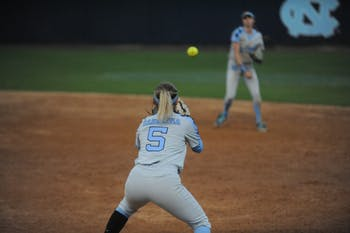 Junior Campbell Hutcherson, number 5, prepares to catch the ball at the UNC softball match against Liberty University on Wednesday, April 10, 2019 at the Anderson Softball Stadium. UNC won 3-2.