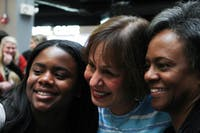 """Chancellor Carol Folt taking a selfie with first-year Alexandra Mauney, exercise and sports science major and daughter of vice-chancellor Felicia Washington, and vice-chancellor Felicia Washington at """"Thank you, Carolina"""" on Tuesday, Jan. 29, 2019, in the Carolina Union. Mauney says that it """"breaks her heart"""" that Folt is leaving, but that it is """"good to know that Folt is leaving with a lasting impact on the Carolina community."""""""