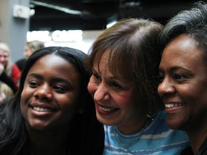 "Chancellor Carol Folt taking a selfie with first-year Alexandra Mauney, exercise and sports science major and daughter of vice-chancellor Felicia Washington, and vice-chancellor Felicia Washington at ""Thank you, Carolina"" on Tuesday, Jan. 29, 2019, in the Carolina Union. Mauney says that it ""breaks her heart"" that Folt is leaving, but that it is ""good to know that Folt is leaving with a lasting impact on the Carolina community."""