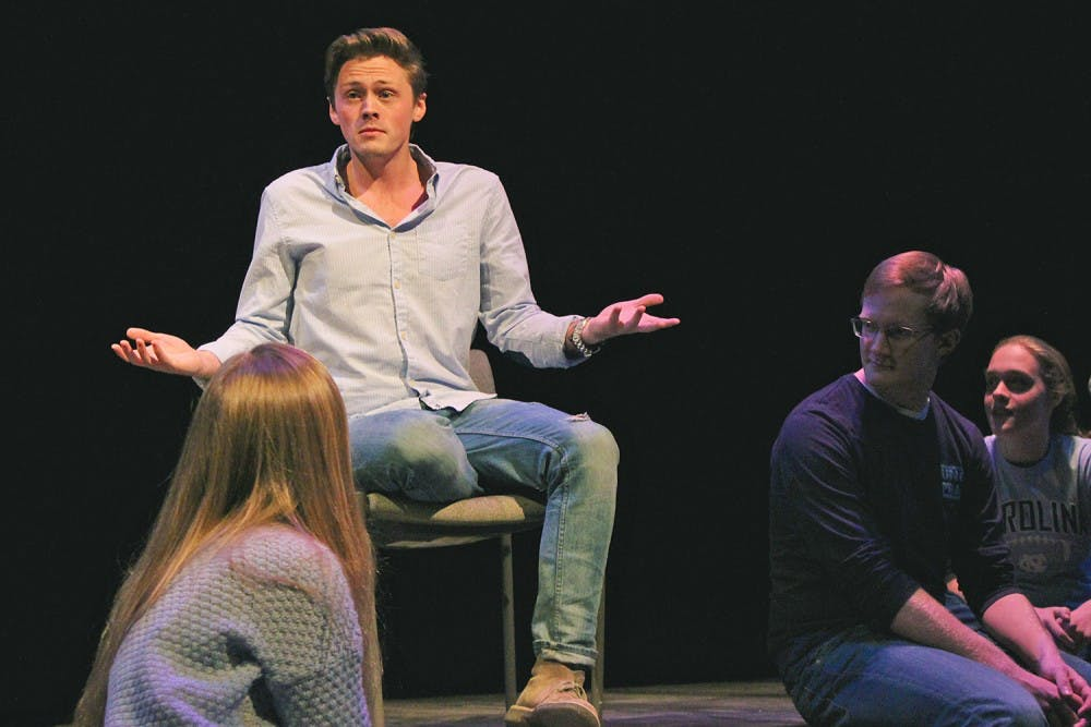 "<p>Christian Payne, a senior dramatic arts and English major, performs ""Just Friends"" during the UNC-Duke collaboration, the Me Too Monologues.</p>"